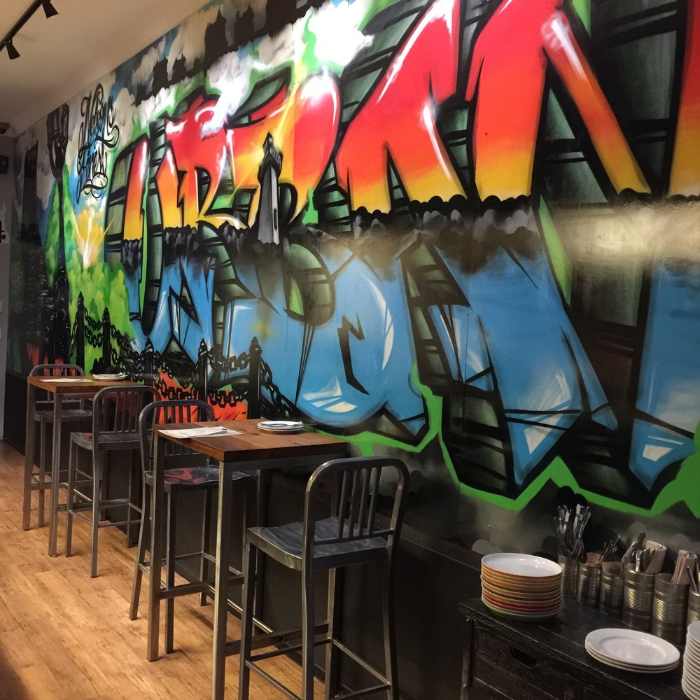 Striking graffiti wall in Urban Eatery