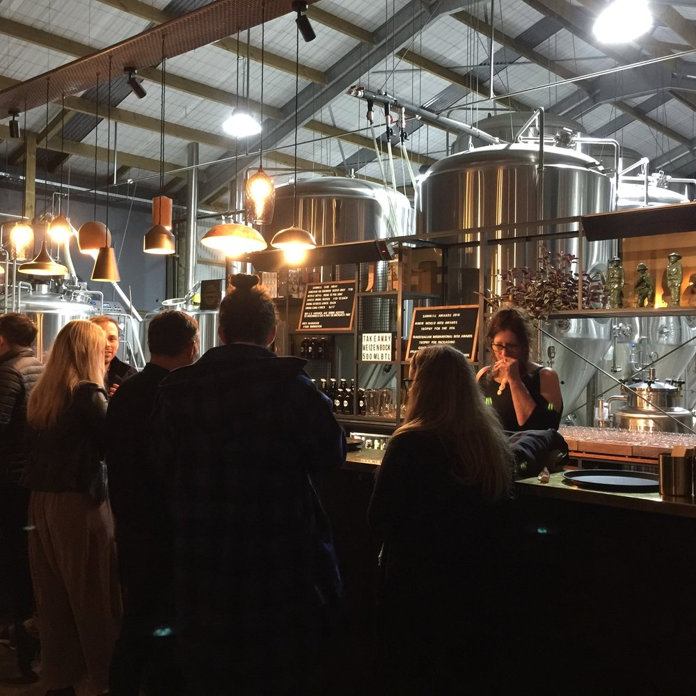 The working brewery is immediately beyond the bar