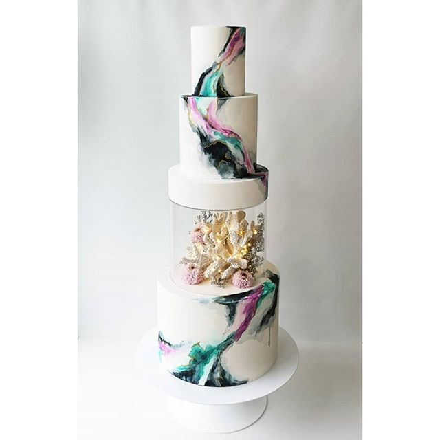 My fave new cake designed for my booth at #fleurvancouver!  A dark and moody watercolour in some of my favourite shades with a smigde of under the sea flare🐚  #weddingcake #cake_trends #cakedesign #cakespiration #modernwedding #cakeart #paintedcake #cakestagram #cakeporm #cakemasters #bridalmusings #weddingstyle #edibleart #ridiculouscakes #moderncake #weddinginspo #designercake  #cakedesigner #cakeandgiraffe #watercolourcake #watercolour