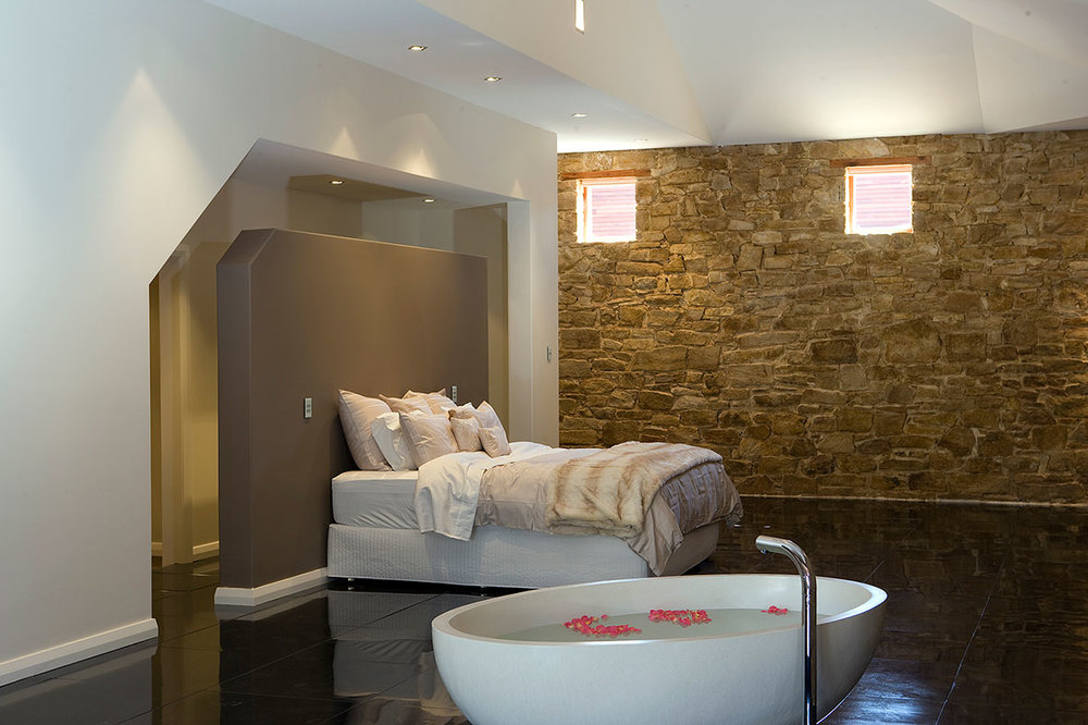 A  free-standing bath compliments the master bedroom