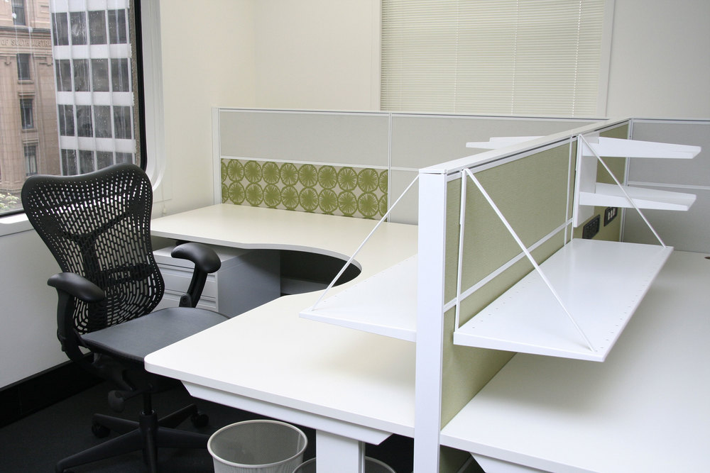 Modern office furnishings complement the existing built fabric