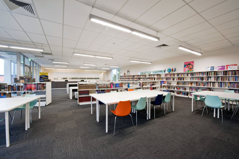 A brightly coloured, open plan layout enables the books to become the focal point of the space