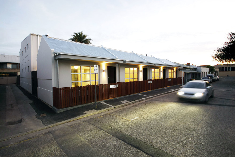 Cairns Street Townhouses provide small scale, award winning housing to the inner city of Adelaide