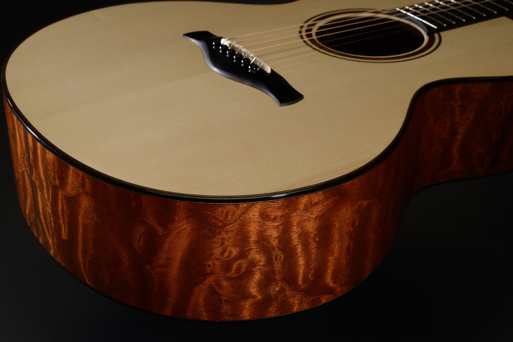 Traugott Model R quilted mahogany guitar