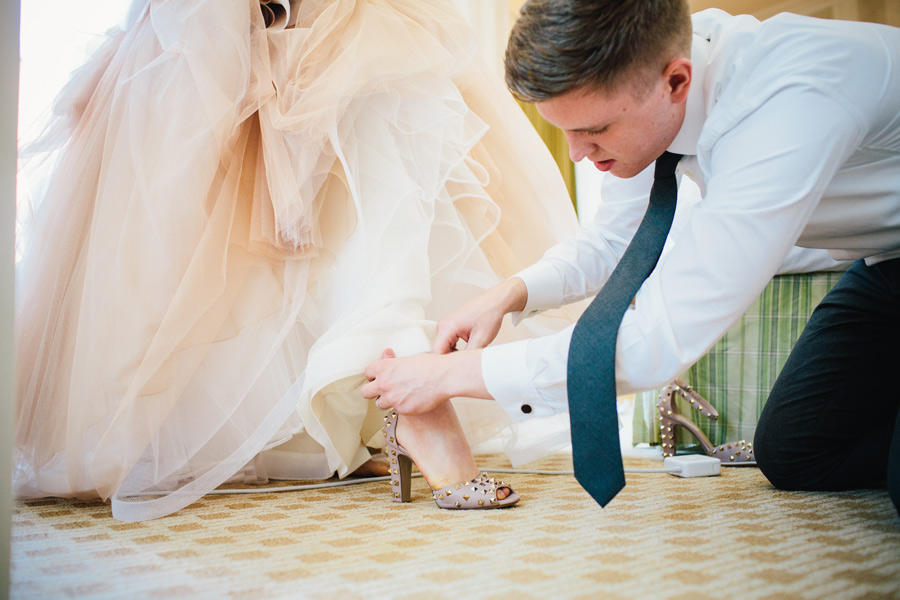 Hannah & Tj Beautiful Wedding at the Four Seasons Boston - Tj helping put on Valentino shoes on Hannah