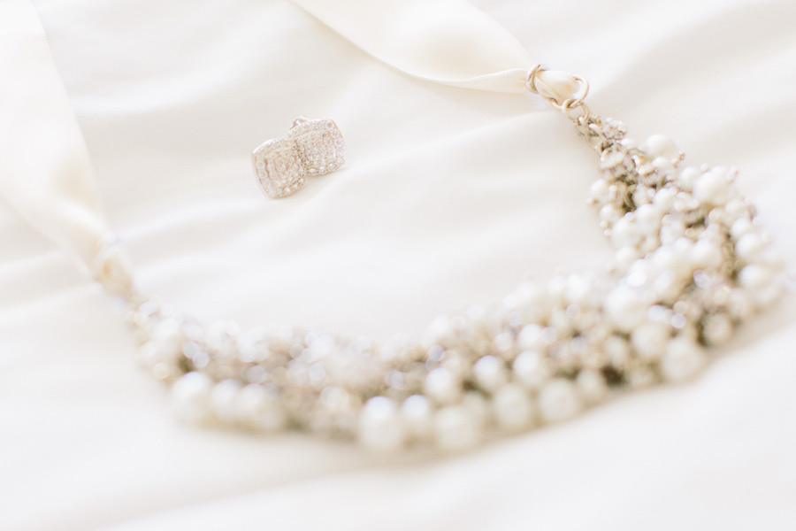 Brides beautiful necklace and earrings at the brewster academy boat  house wedding in Wolfeboro, NH