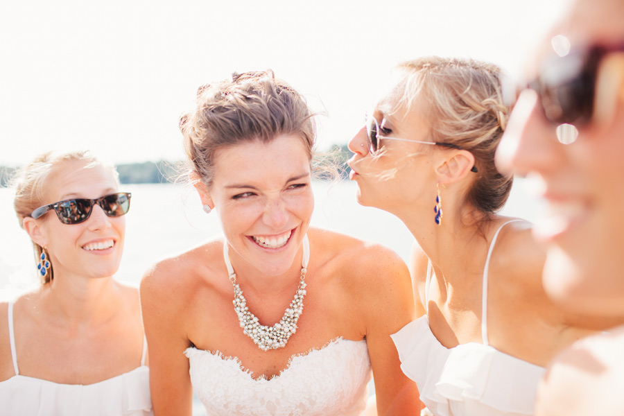 Bridesmaids having fun with bride on a boat on lake winnipesaukee wedding photography