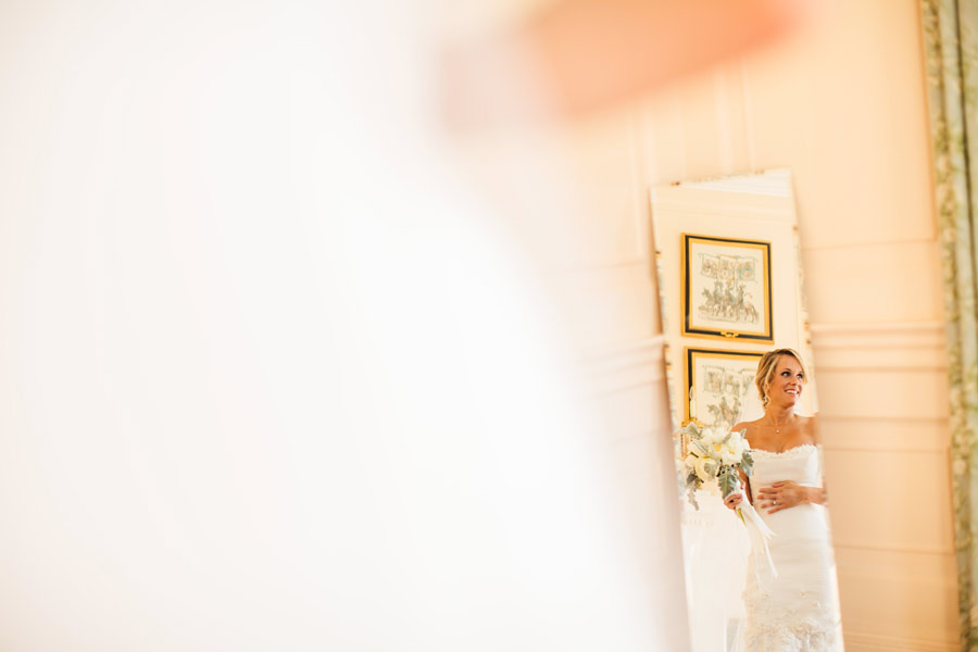 Beautiful bride inside of lowndes grove plantation house in the mirror with wedding dress