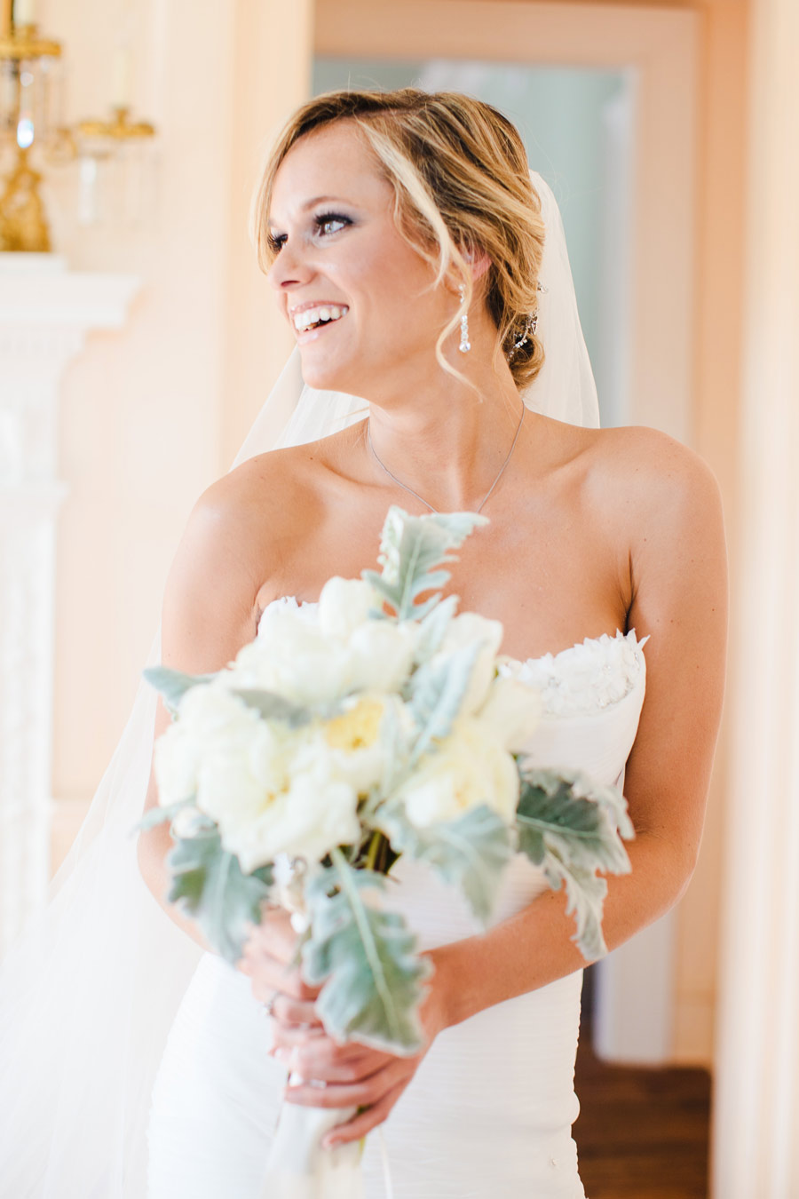 Beautiful southern weddings bride at the Lowndes Grove Plantation with her bouquet in charleston, SC wedding photography