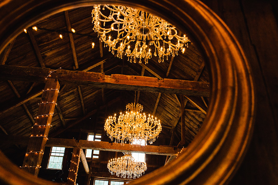 amazing chandeliers at the bishop farms wedding venue rustic bar location in new england