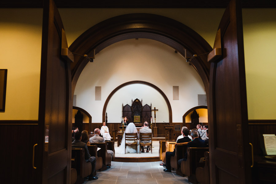 couple inside our lady of mercy chapel at salve regina wedding photographers