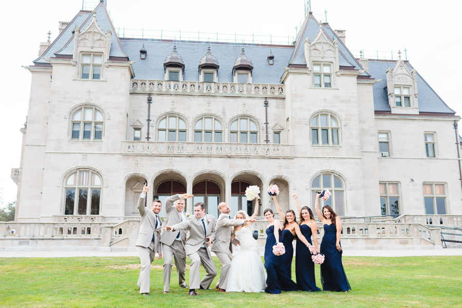 awesome wedding party having fun at the cliff walk mansions in newport , ri - wedding photographers