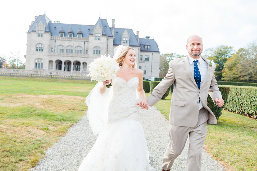 bride and groom running at a mansion at newport, RI on the water - wedding photographers