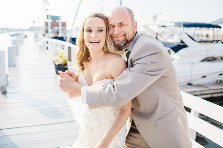 fun moment of a lovely married couple on the docks in newport, ri at their wedding