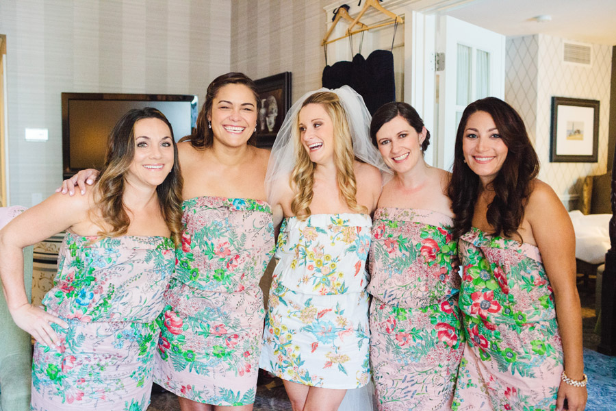 bridesmaids having fun and smiling in their  Pretty Plum Sugar robes before the wedding in newport, RI
