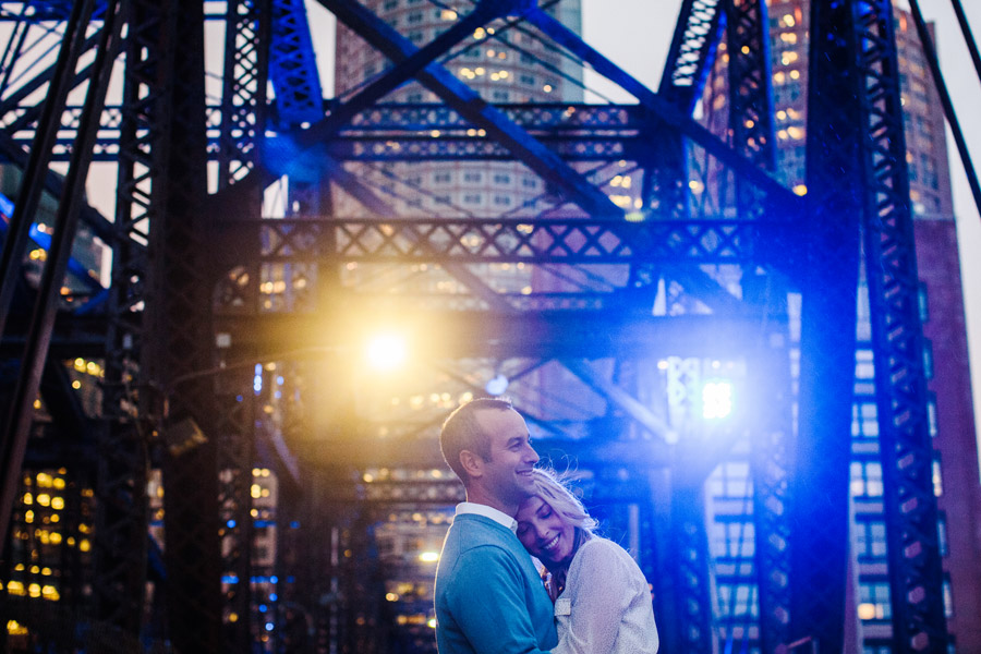 John & Cate's awesome downtown boston engagement photography during a beautiful boston sunset on a bridge