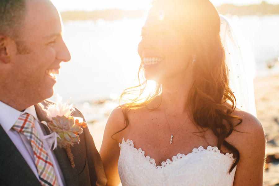 beautiful married couple smiling at scituate harbor beach yacht club wedding photography