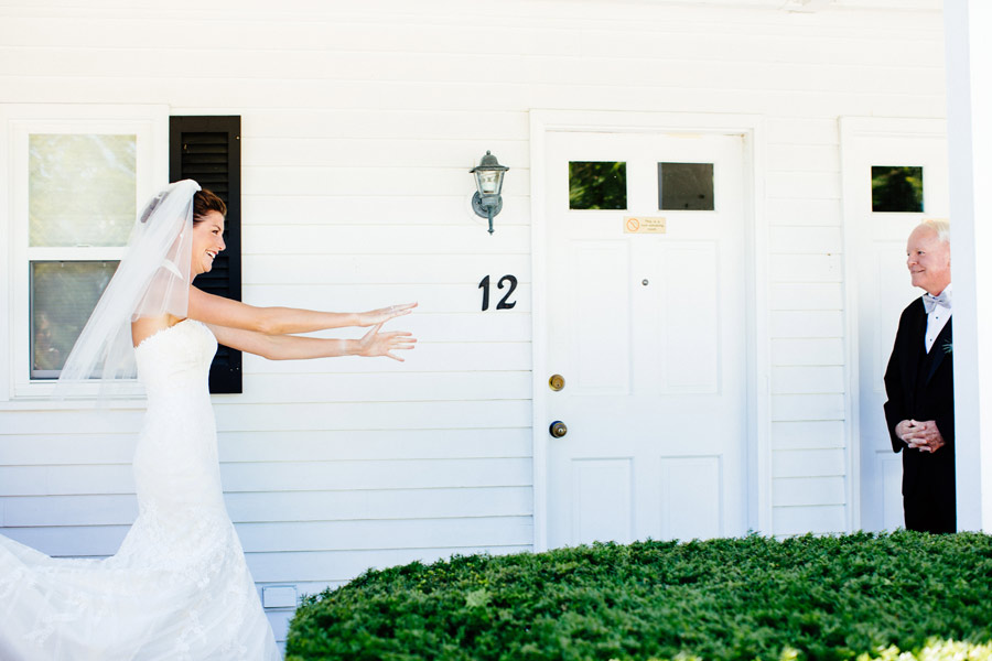 gorgeous bride reaching for her father for a first look , wolfeboro , nh wedding