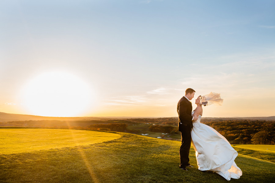 beautiful view of new england with bride and groom together at granite links during sunset