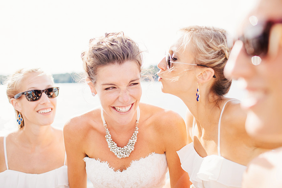 beautiful bride on a boat with bridesmaids on lake winnipesaukee - nh wedding photographer