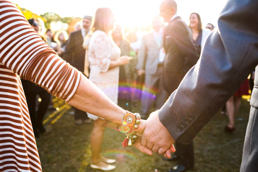 diy wedding ceremony family holding hands with beautiful light