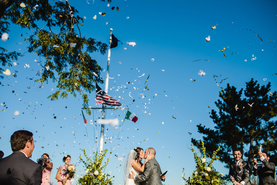 confetti poppers during the first kiss at scituate yacht club wedding in new england