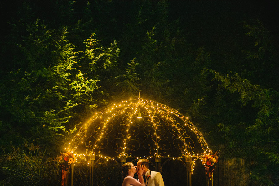 New hampshire wedding photographers - granite rose wedding at night -outside ceremony couple kissing