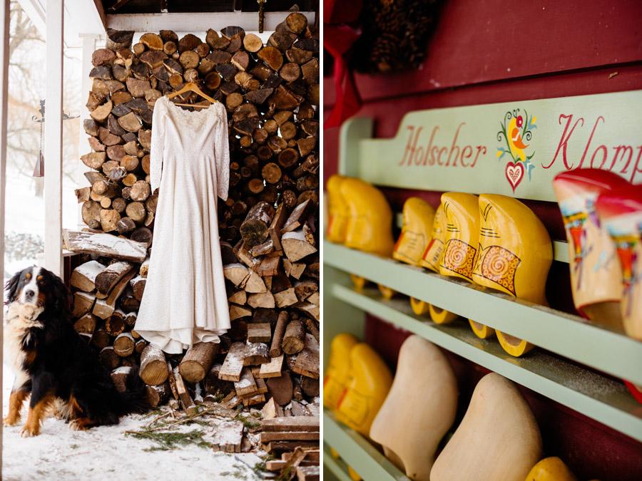 beautiful rustic wedding dress hanging on wood