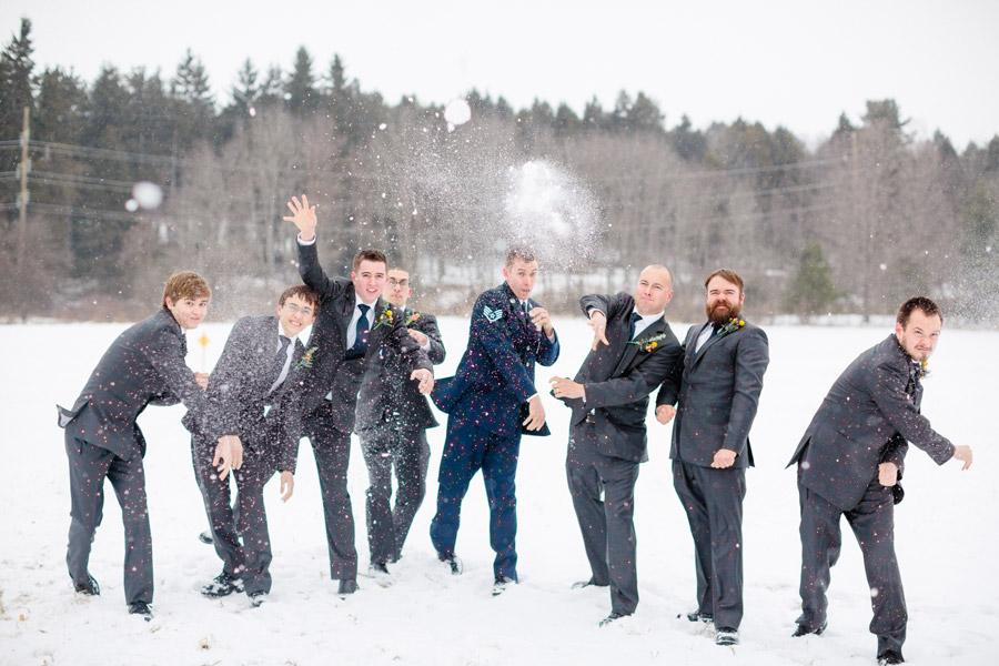 groomsmen throwing snowballs in a wedding