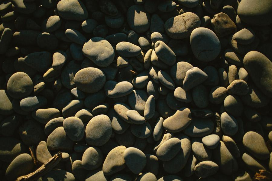 oregon coast rocks with sun light and shadows exploring