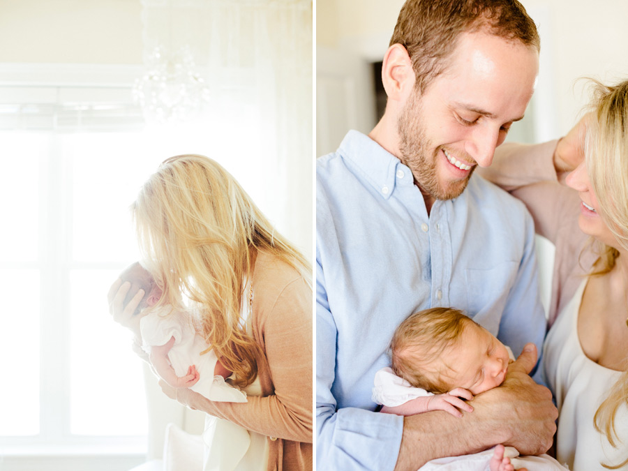 mom and dad holding their baby during boston newborn photography