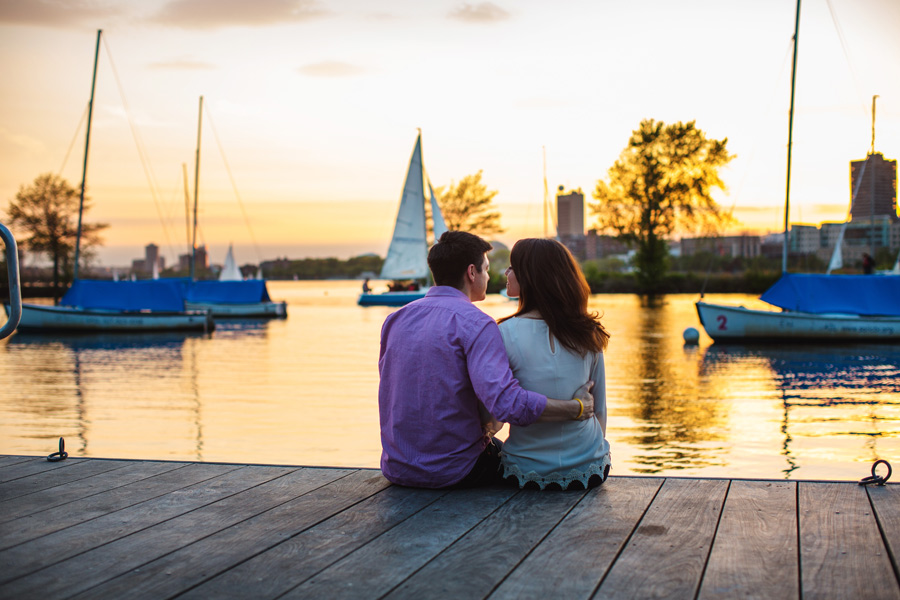 pretty couple on docks in boston engagement photography during sunset