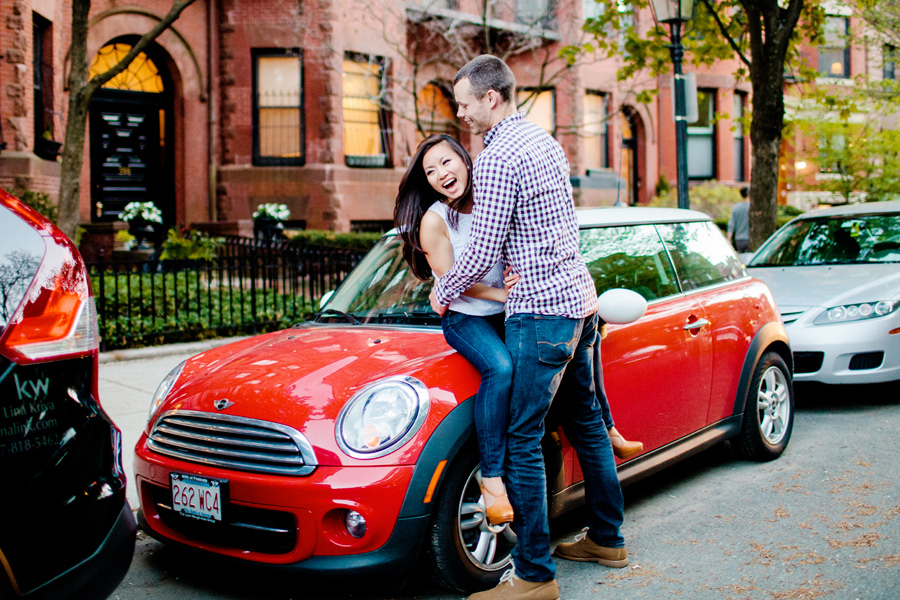 couple on a mini cooper in boston during engagement session love