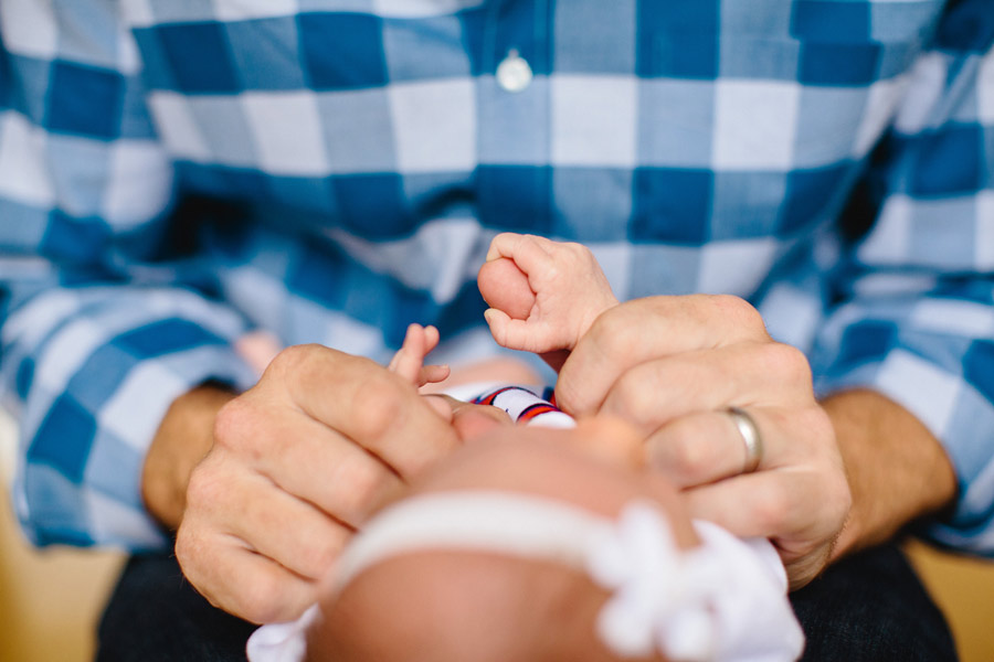 father and baby holding hands in boston newborn photographer
