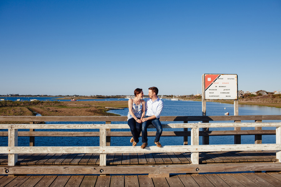 couple on bridge in nantucket during their engagement photography