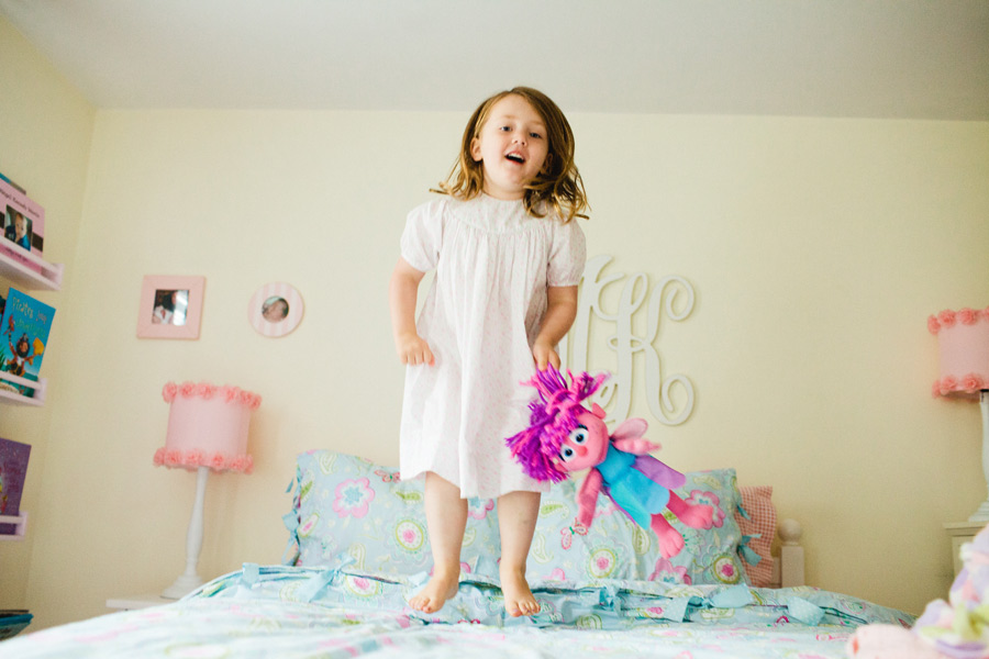girl jumping on bed boston lifestyle kid portrait photographer