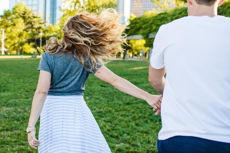 fun couple in boston running around boston lifestyle photographer