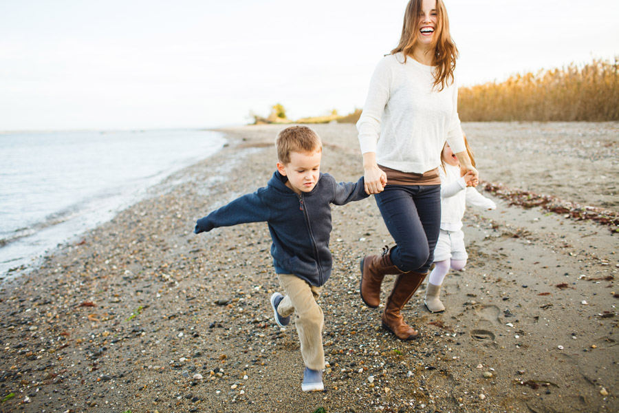 Lifestyle beautiful family photography on a beach in rhode island - boston photographer mikhail glabets running on beach