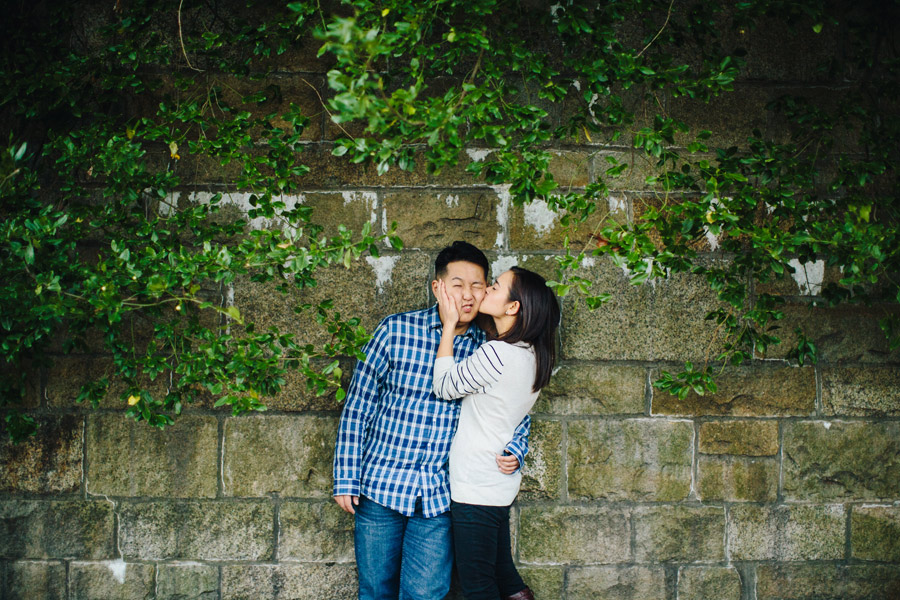Fun couple engagement session at wellesley College campus fun lifestyle mikhail glabets on ivy wall