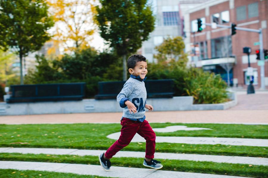 Boston Downtown family photographer fun lifestyle family photos in boston mikhail glabets kid running