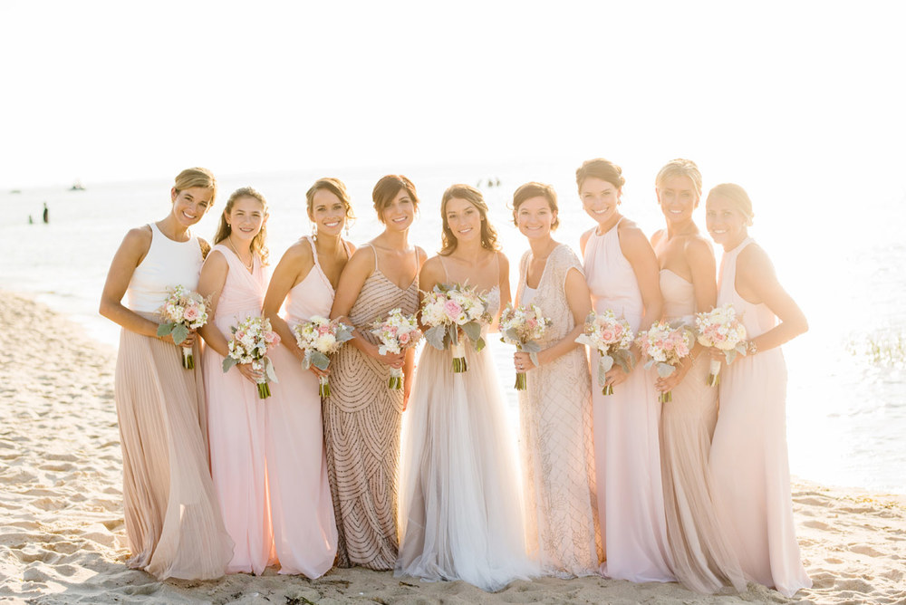 stunning bridesmaids on the beach at the ocean edge resort , cape cod wedding photographers