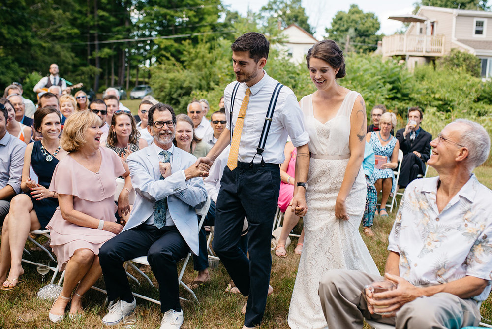 high five going down the isle on the wedding day new england rustic wedding