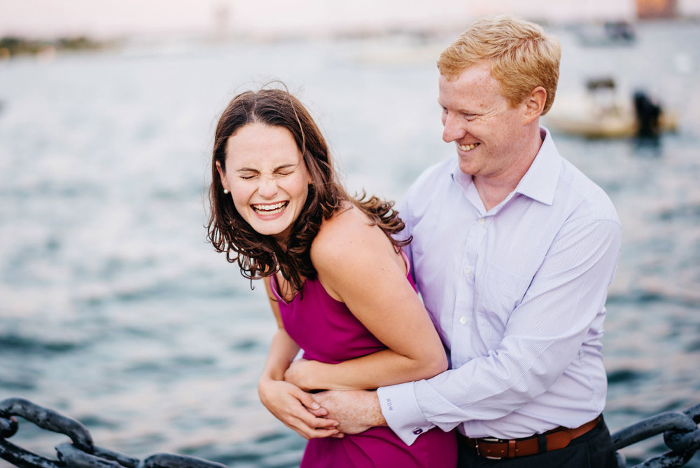 boston harbor couple being fun during their engagement session