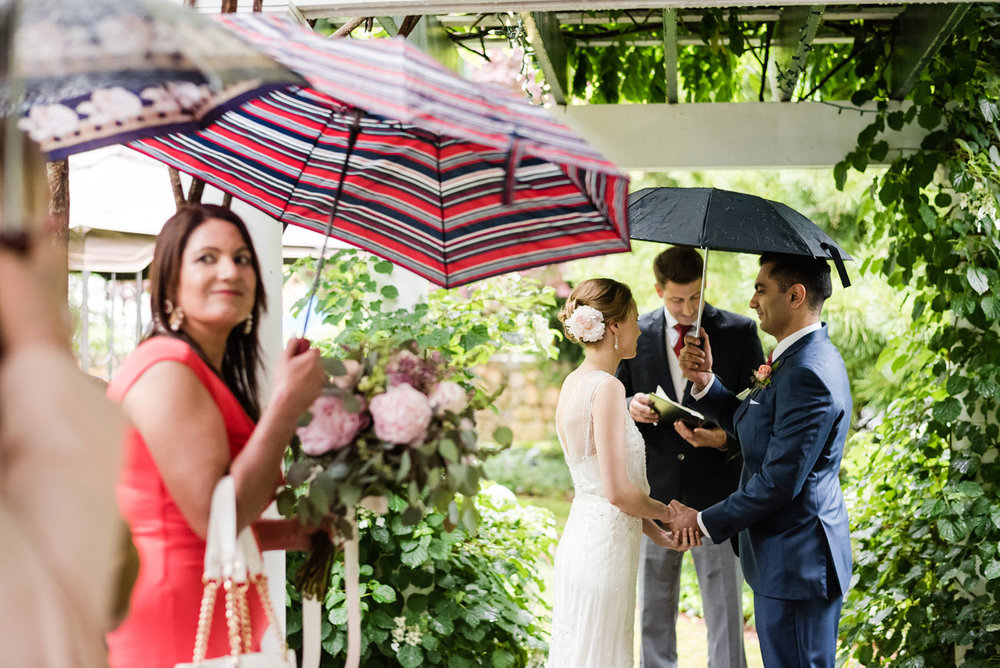 bride and groom get married in the rain, small intimate wedding in cape cod