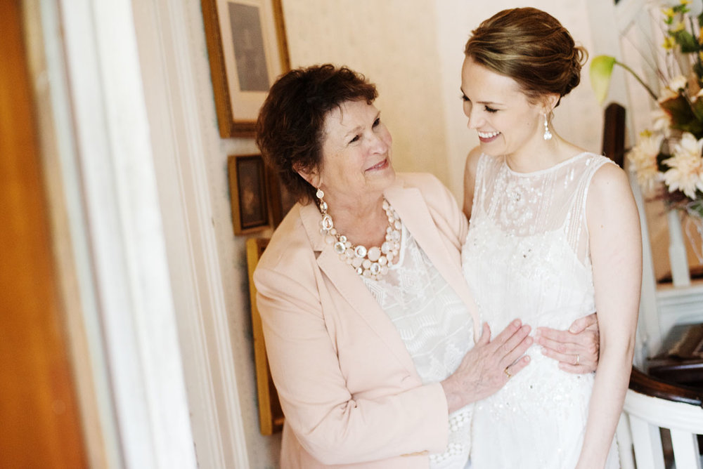 cute moment with bride and mom at her intimate house wedding in sandwich, ma cape cod weddings