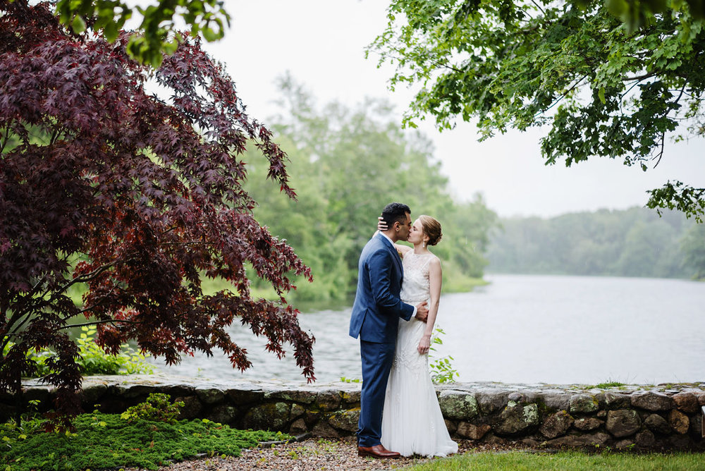 bride and groom kissing on a rainy day in cape cod, cape cod weddings sandwich weddings