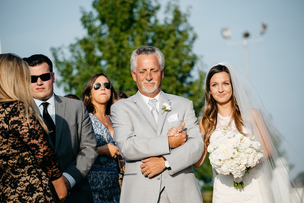 father walking the bride down the aisle in a newport outdoor glamorous wedding newport outdoor venues