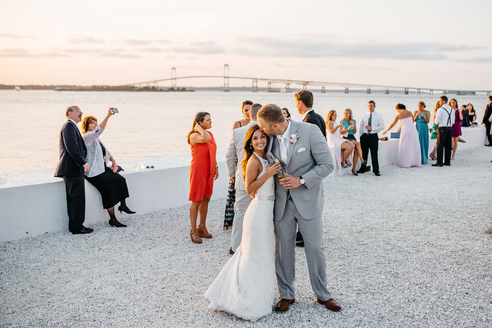 bride and groom at belle mer with bridge views in newport ri
