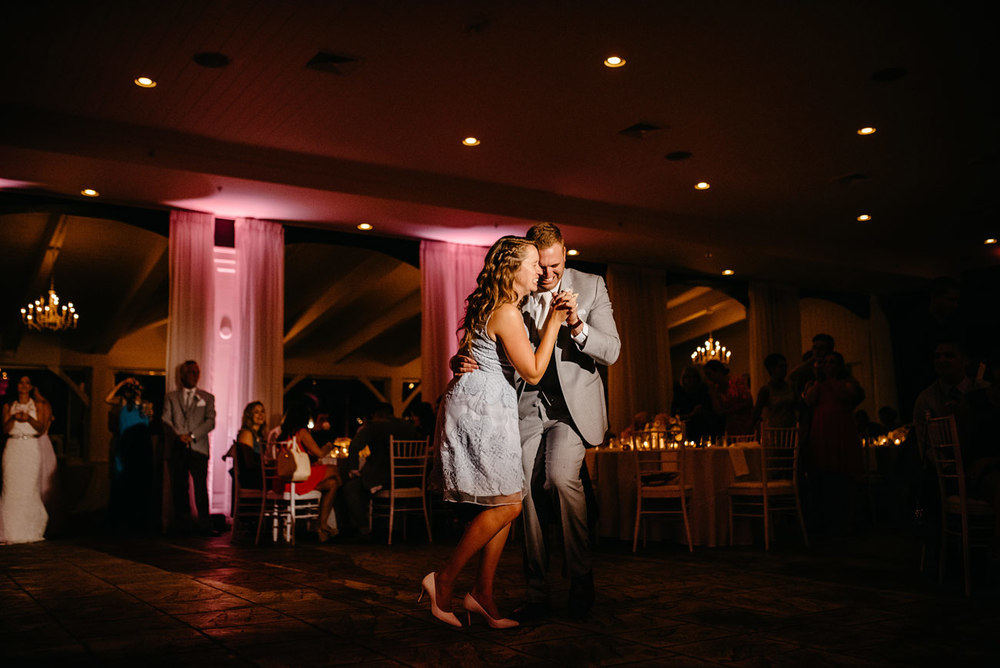 groom and sister dancing at belle mer island house indoor weddings
