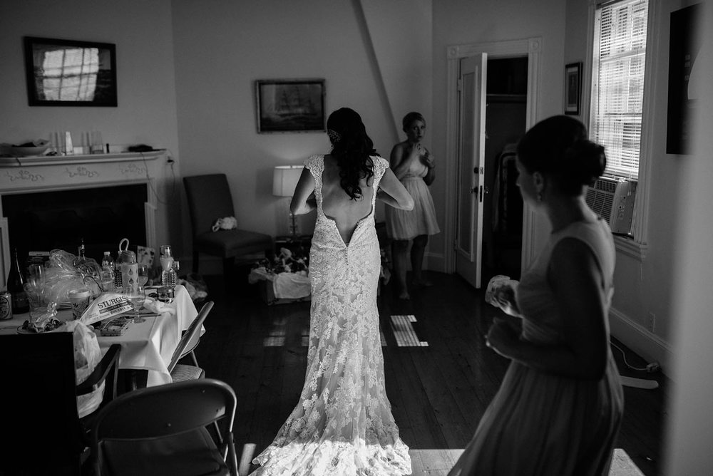 bride getting ready in black and white fun lifestyle eastern point yacht club